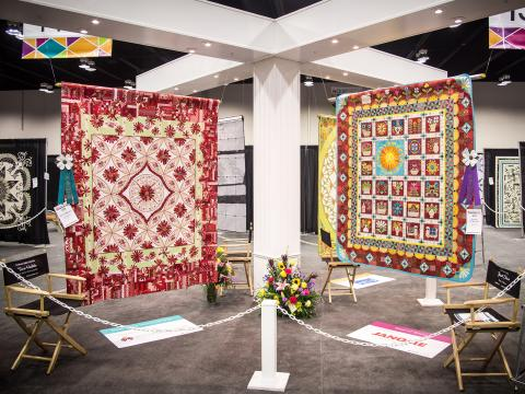 Competitor quites at Spring AQS QuiltWeek in Paducah, Kentucky