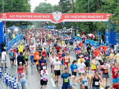 Runners finishing the Peachtree Road Race in Atlanta, Georgia